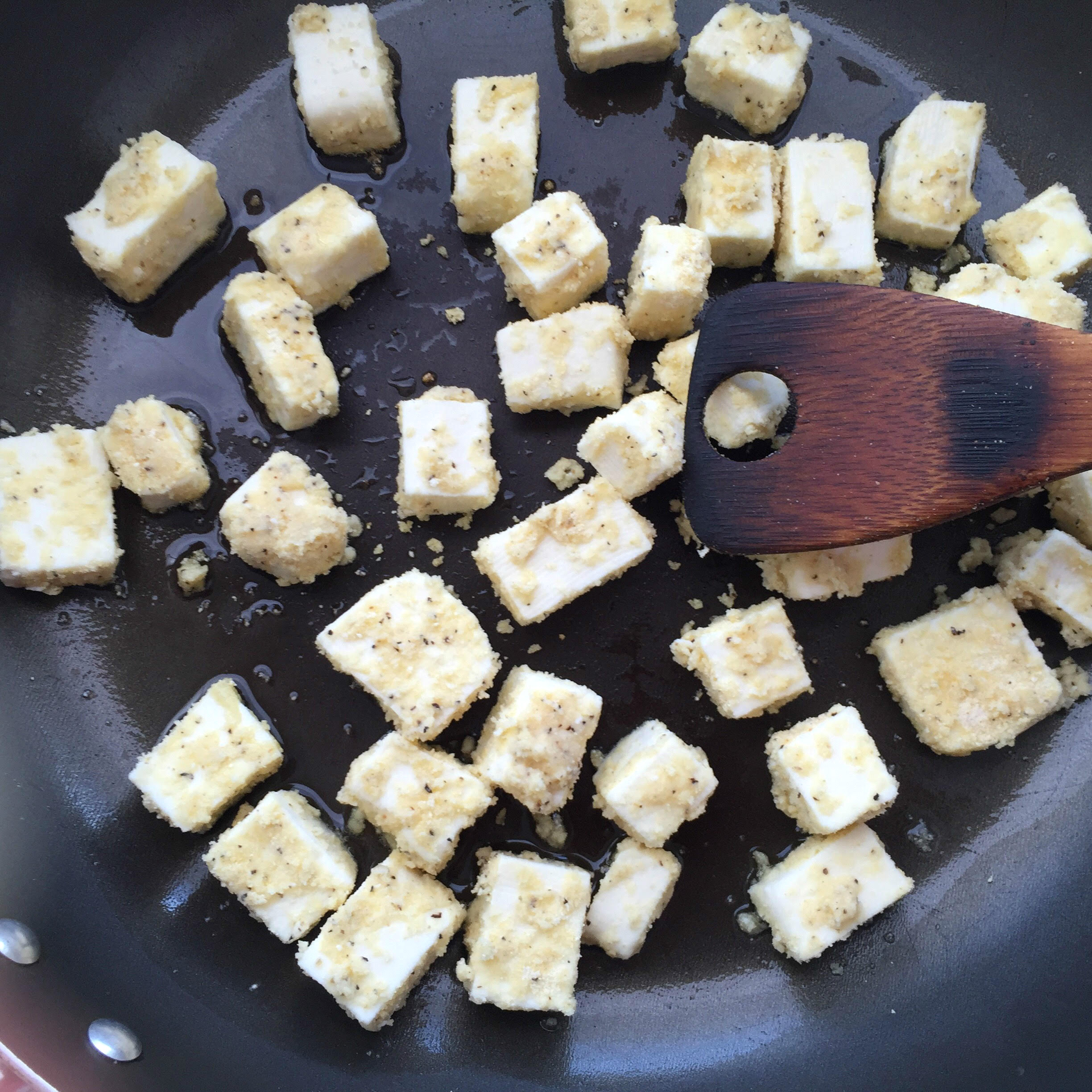 Fry paneer pieces on skillet